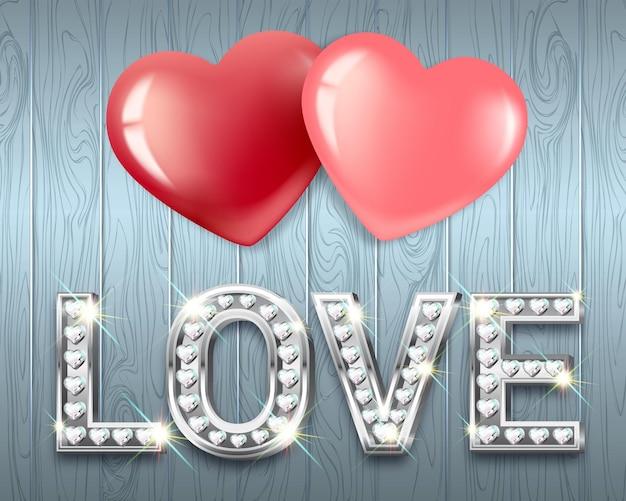 사랑이라는 단어와 함께 두 마음. 반짝이는 다이아몬드가 세팅 된 화이트 골드 하트 모양의 글자. 발렌타인 데이