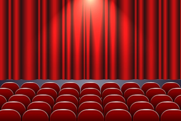 Theater auditorium with rows of red seats and stage with curtain