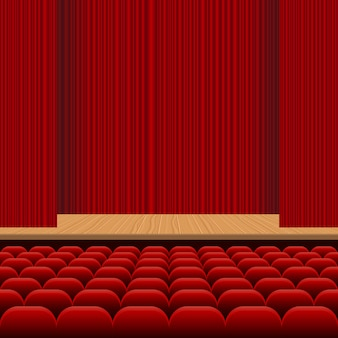 Театральный зал с рядами красных сидений, деревянной сценой и иллюстрацией красного бархатного занавеса