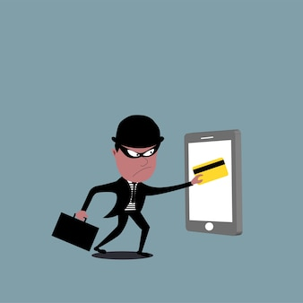 Thief holding a credit card. hacker stealing credit card data.