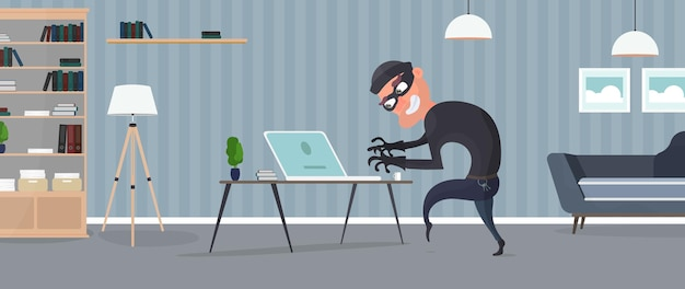 Thief in the house. a robber steals data from a laptop.