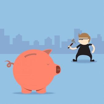 泥棒は、ピギーバンクを壊すためにハンマーを使用する