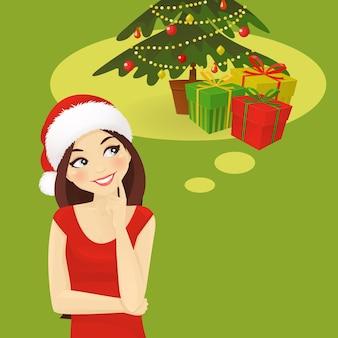 선물을 올려다보는 산타 모자를 쓴 생각하는 여자