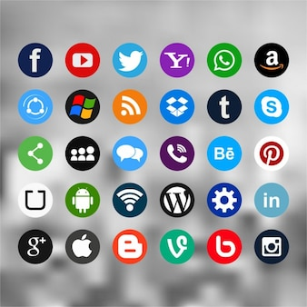 Thirty useful icons for social networks on a blurred background