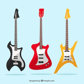 Three bass guitars with different colors and designs