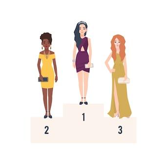 表彰台に立って賞を受賞したエレガントなイブニングドレスを着た3人の美しい女性。