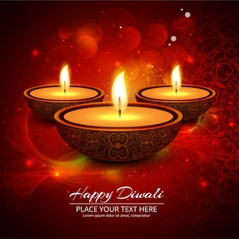 Three candles on a bright background for diwali