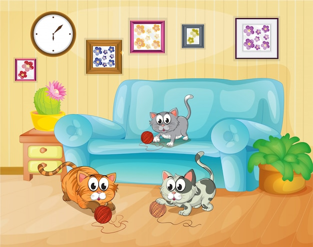 Three cats playing inside the house