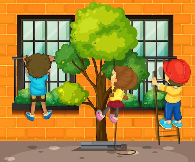 Three children climbing up the window