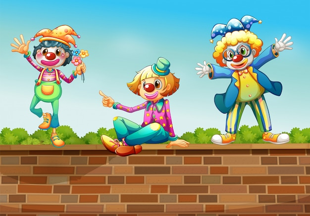 Three clowns above the wall