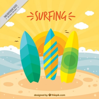 Three colored surfboards on the beach background