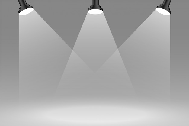 Three focus sportlights background in gray color
