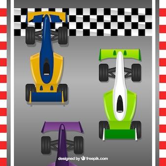 Three formula 1 racing car crossing finish line