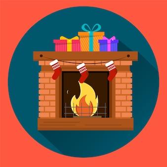暖炉にプレゼントが入った3つのギフトボックス