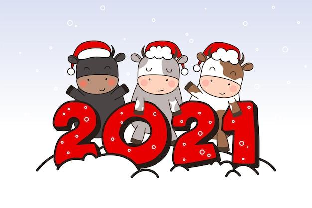 Three happy cute little bulls in santa hats stand near the inscription 2021. .
