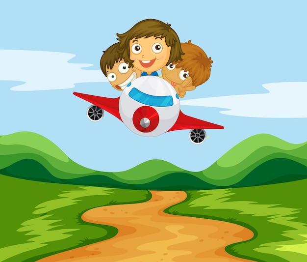 Tre bambini che volano in aereo sulle colline