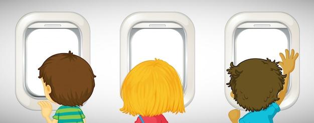 비행기 창 밖을 바라 보는 세 아이