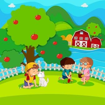 公園に木を植える3人の子供たち