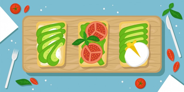 Three kinds of avocado toast. beautiful food background with wooden cutting board, cherry tomatoes, salt crystals and cutlery. flat  illustration. the top view.