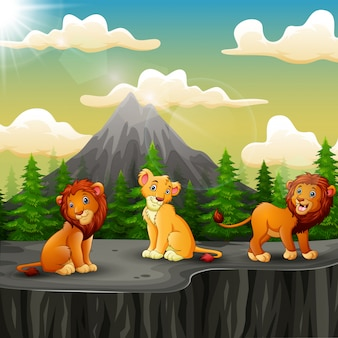Three lion cartoon enjoying on the mountain a cliff