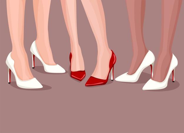 Three pairs of sexy female legs wearing elegant high heels.