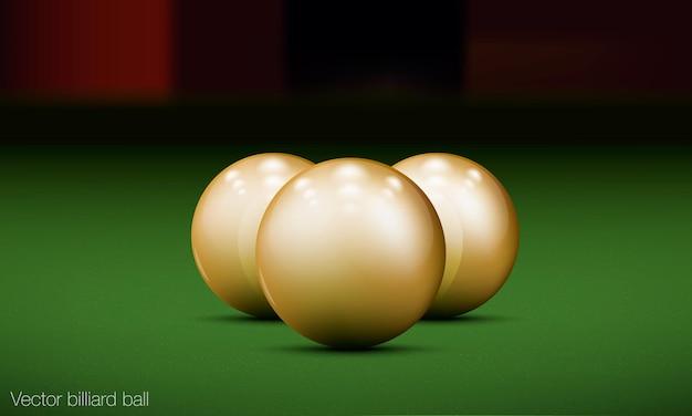 Three realistic billiard balls on a pool table