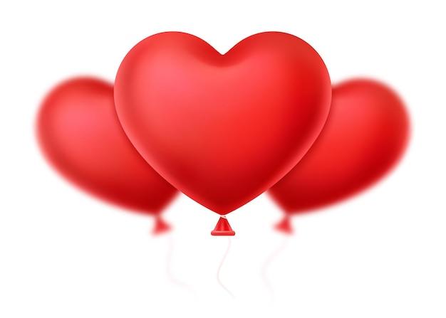 白い背景の上の風船の形をした3つの赤いハート。バレンタイン・デー。