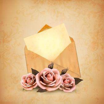 편지와 함께 오래 된 봉투 앞 세 장미