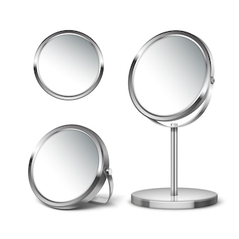 Three round mirrors on different stands and without isolated on white background