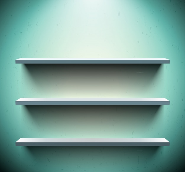 Three shelves on blue wall