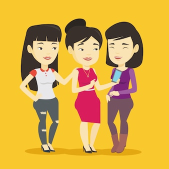 Three smiling friends looking at mobile phone.