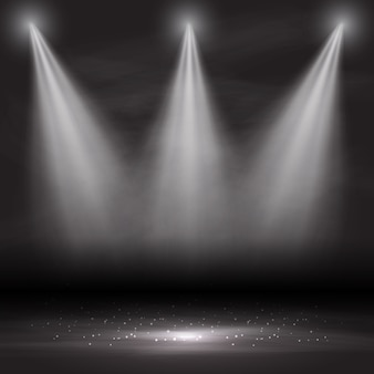 Three spotlights shining down in an empty room
