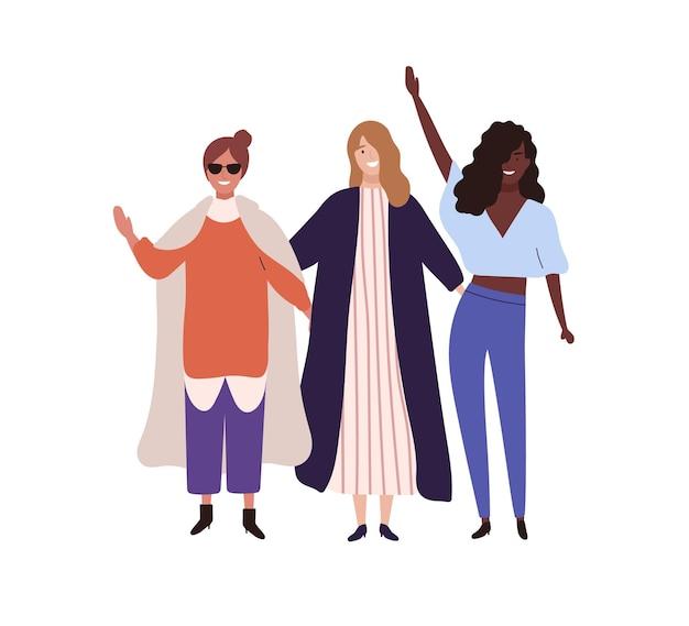 Три стильных счастливая девушка поднимая руки вектор плоской иллюстрации. группа модных подруг улыбается, изолированные на белом фоне. модная женщина, стоя вместе, весело.