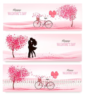 Three valentine's day banners with pink trees and hearts.