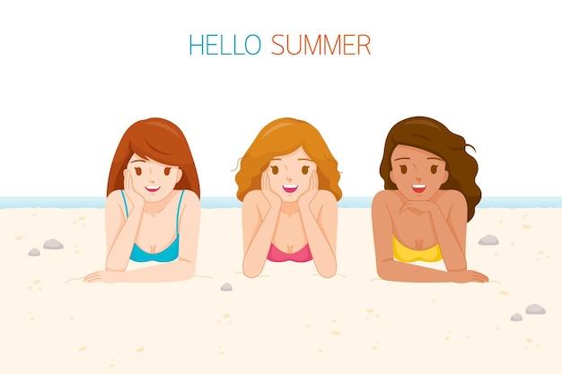 Three women wearing bikini lying on beach