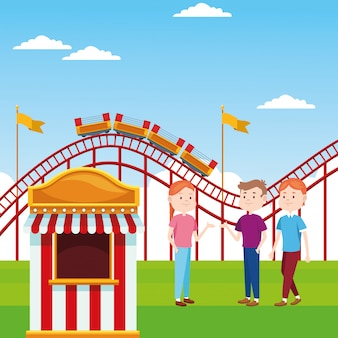 Ticket booth and happy people standing over roller coaster and landscape