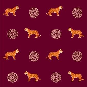 Тигр животных и китайский круглая рамка, оформленная на красном фоне.