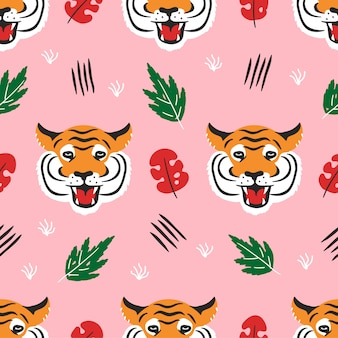 Tiger face and tropical leafs seamless pattern.