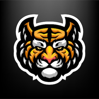暗い灰色の背景に分離されたスポーツとeスポーツのロゴのタイガーヘッドマスコットイラスト
