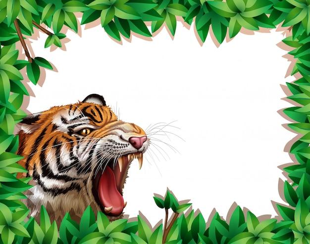 Тигр в рамке из листьев