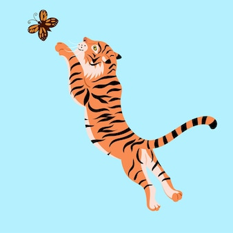 A tiger is playing with a butterfly.