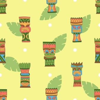 Tiki hawaiian mask with tropical palm leaves - seamless pattern