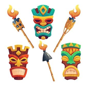 Tiki masks and hawaiian tribal totem and burning torches on bamboo stick