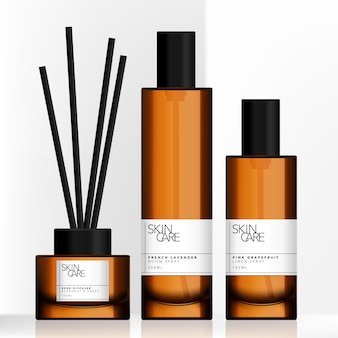 Tinted brown glass or plastic tall spray bottle and charcoal reed aromatic home diffuser set
