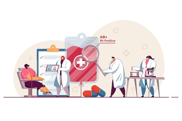 献血前に患者を診察する小さな漫画の医者