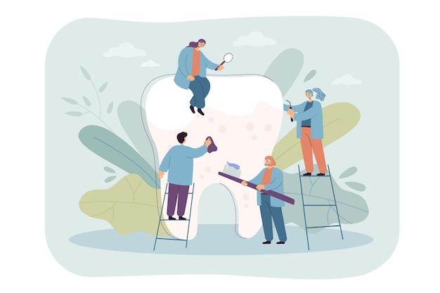 巨大な歯の世話をしている小さな歯科医