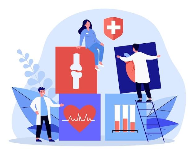 Крошечные врачи с большими медицинскими карточками