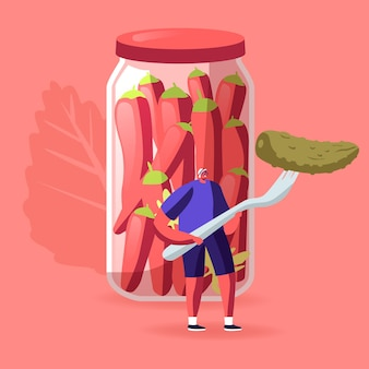 Tiny male character holding huge pickle on fork stand at glass jar with marinated red chili peppers. cartoon illustration