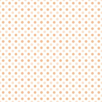 白い背景のシームレスなパターンに小さなオレンジ色のドットの半分のドロップの繰り返し