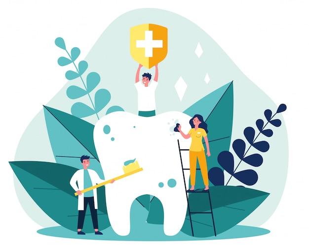 大きな歯のイラストを掃除する小さな人々